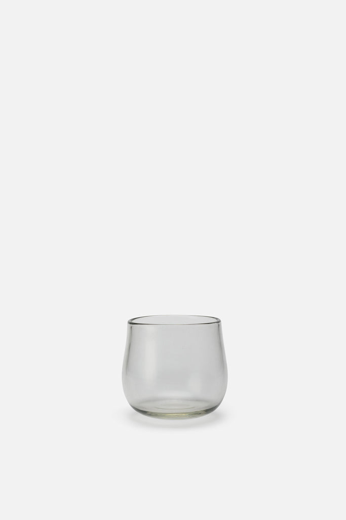 A rounded glass vase with earthy, imperfect shape.