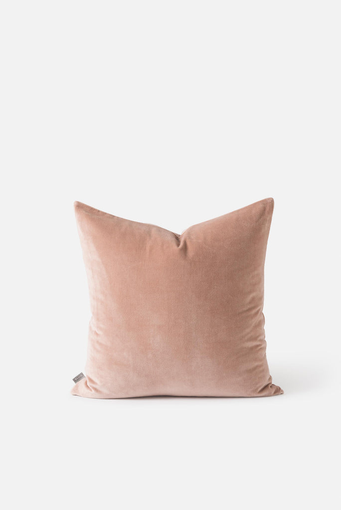 A square cushion in a luxurious velvet in a soft neutral pecan colour.