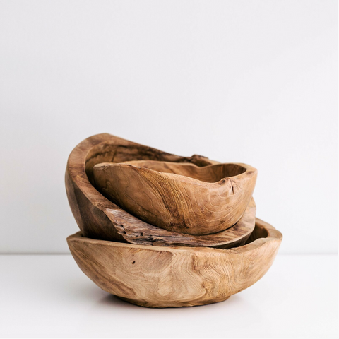 This timber serving bowl is a structural piece with exquisite imperfections.