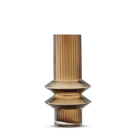A petite sculptural hand cast glass vase with zig-zagging detail at the base.