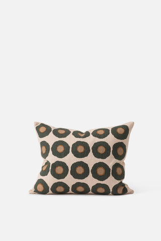 A patterned cushion by Citta with a sunflower motif on a neutral background with brown and green flowers.