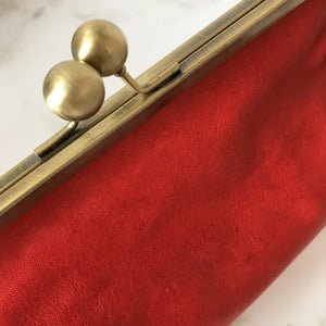 Coral Leather Clutch Bag