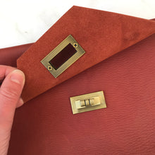 Load image into Gallery viewer, Twist Turn Leather Clutch