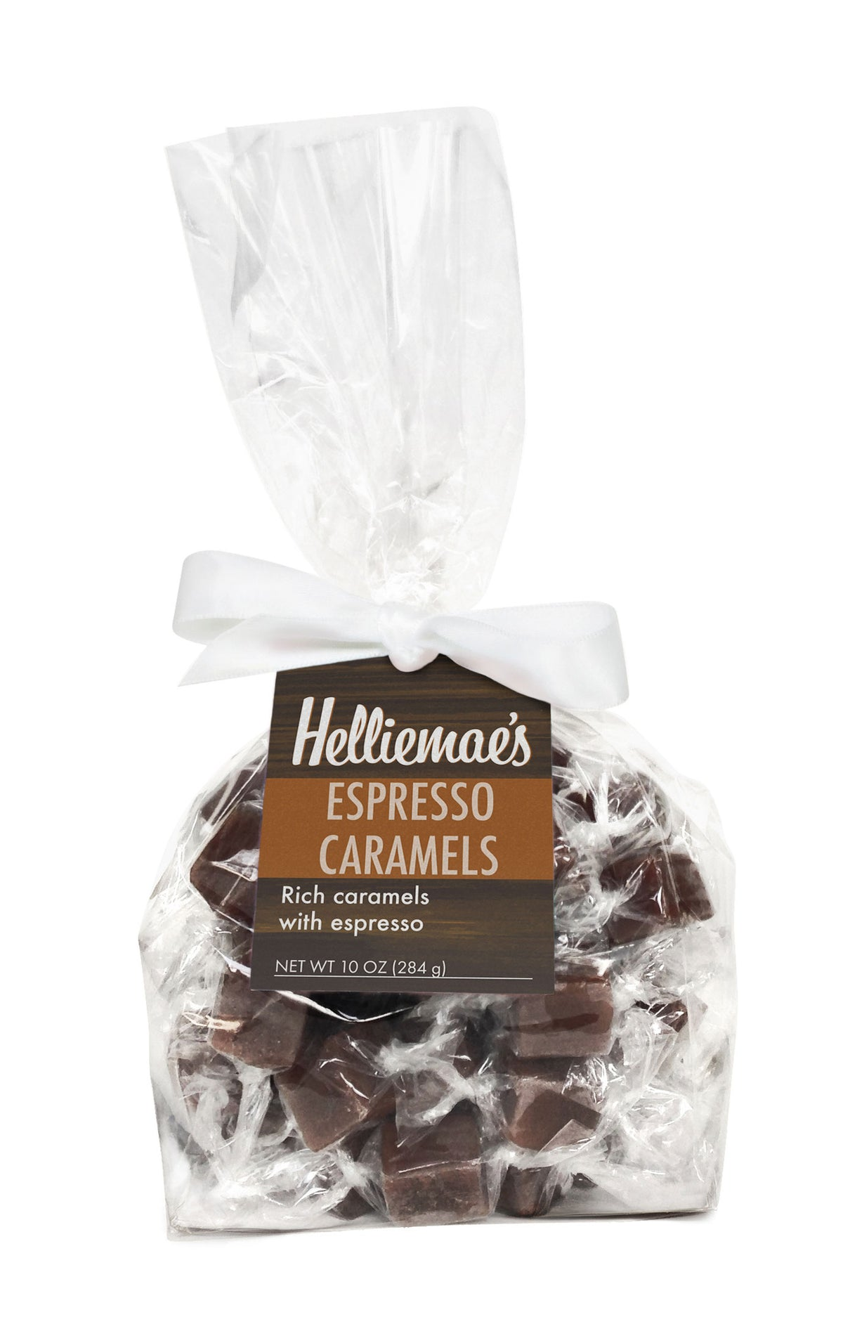 Helliemae's Espresso Caramels large gift bag, clear cello bag with gathered top, fastened with white satin ribbon and colorful brown hangtag, with effect of milk paint on a barn wall.
