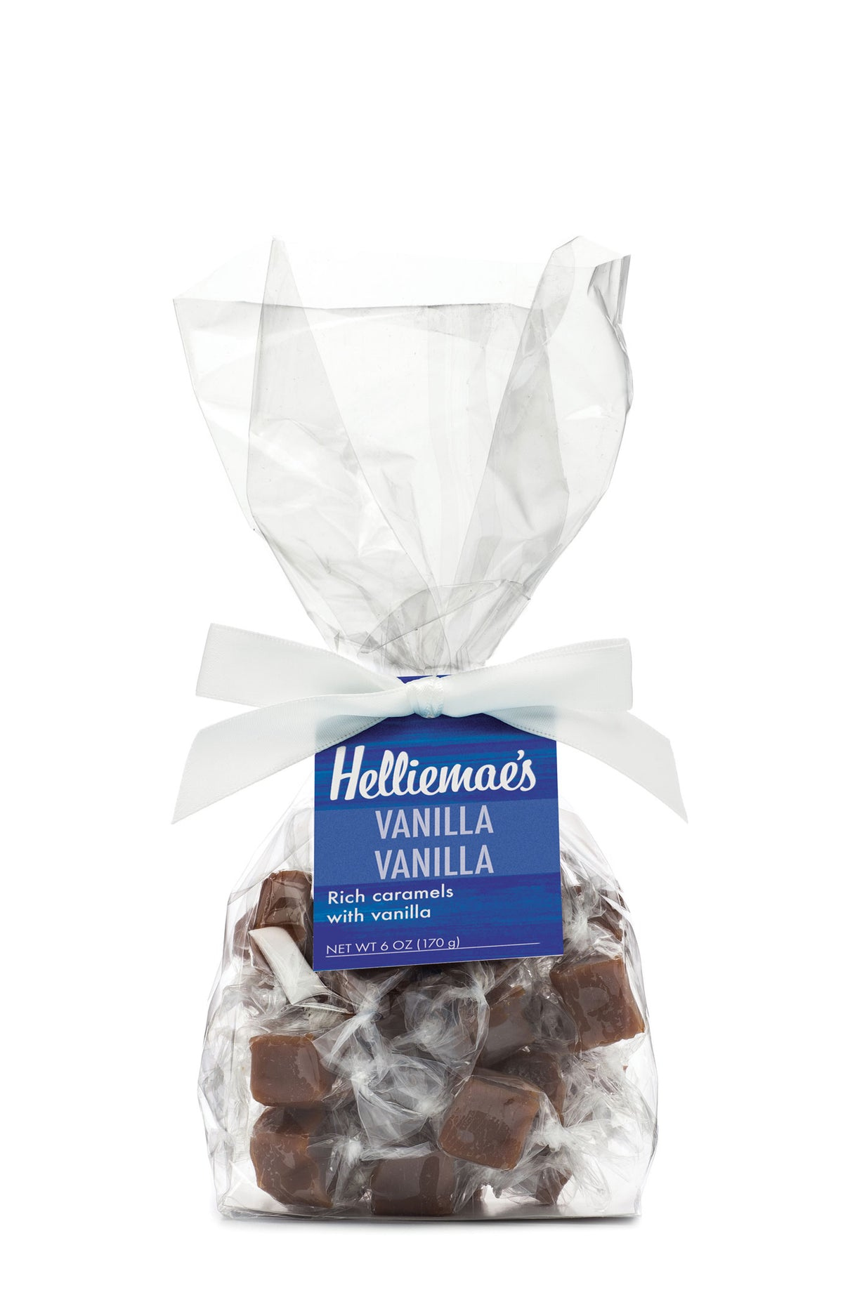 Helliemae's Vanilla Vanilla Caramels medium gift bag, clear cello bag with gathered top, fastened with white satin ribbon and colorful blue hangtag, with effect of milk paint on a barn wall.