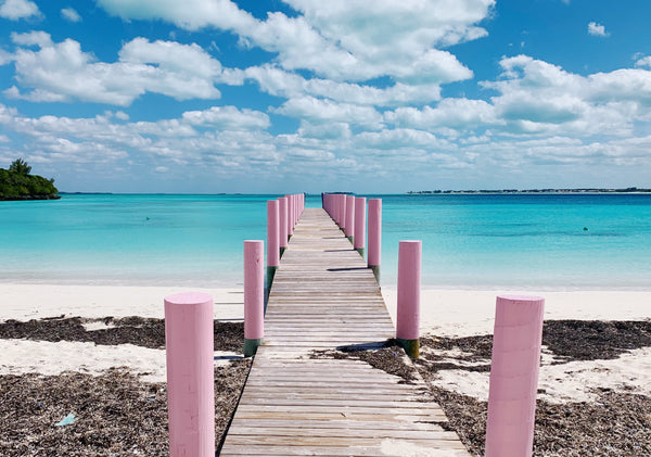 Bahama Beach club in Treasure Cay pink pier in Abaco by Malibu Apothecary