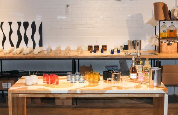 Make your own candle by choosing your scent, candle container, and complimentary gift wrapping