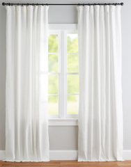 Pottery Barn luxury white linen blackout curtains in living room