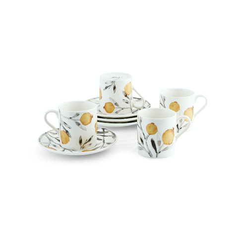 white espresso mugs and saucers with grapefruits painted on them
