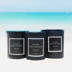 Coastal Black Box Bundle candle gift set with three clean natural coconut wax candles sitting on the beach in Turks & Caicos