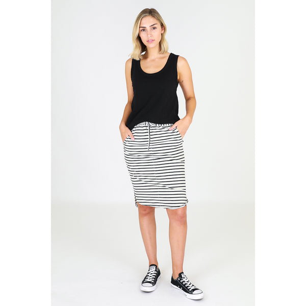 Olivia Skirt by 3rd Story has a gold toggle drawstring that sits at the waist, and side pockets for a relaxed and laidback style. This women's skirt features a hemline that finishes at the knee and is rounded at the sides, with side split detailing. The back hem is slightly lower and finishes below the back of the knee, which is also rounded at the sides as well.   Team this skirt with a muscle tee and sneakers for a daytime look, or slides and a singlet tank for a casual day or running errands.  It is unli