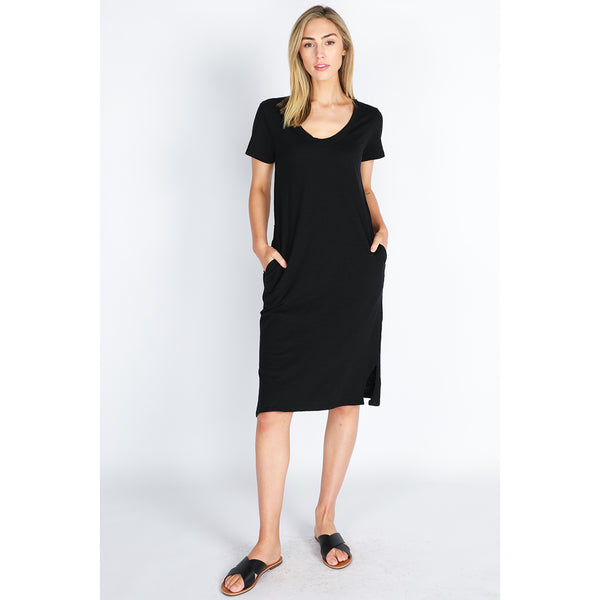 Rachel Dress by 3rd Story has a scooped neckline and short sleeves. This women's dress features side pockets and splits at the sides. It has a straight hemlines. The front hem falls to midi length. Available in Black and Indigo  Pair with your favourite white sneakers and a cross shoulder bag for a casual day.  It is unlined, stretch, and opaque. Made from 100% Slub Cotton.  Style is true to size.  Models are 1.78 – 1.8m tall, so most dress/skirt styles will end near and below the knee for the average heigh