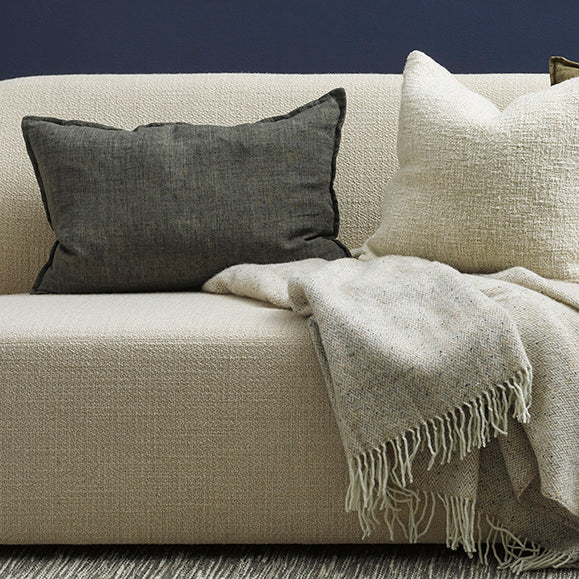 Arcadia Cushion by Mulberi - Raw texture is celebrated by natural colourways that create an easy, contemporary aesthetic. Our Arcadia collection features a 1cm flange edge, and its 40x60cm size is perfect for adding the finishing touch to your interior. Pair with our Cassia cushion to add interest with shape and size.  100% Linen Includes feather inner