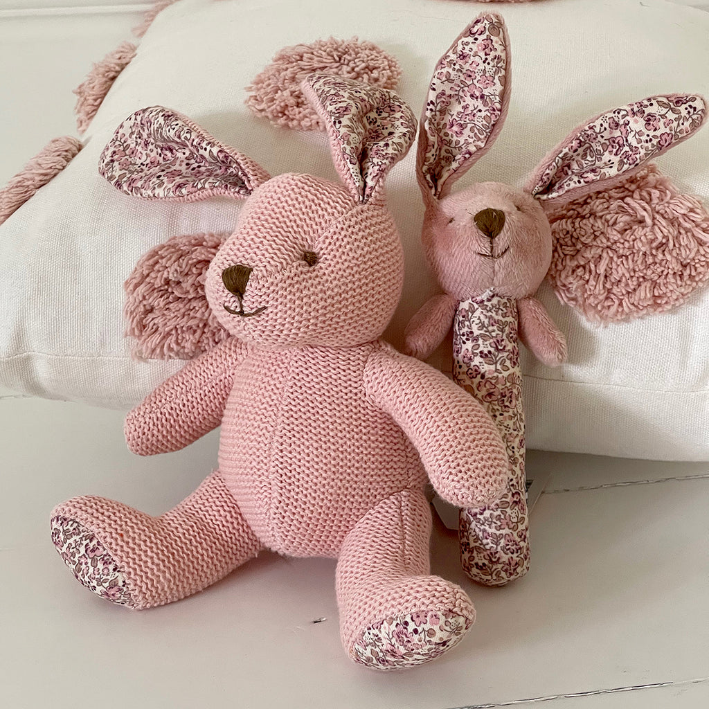 Knitted in beautifully soft cotton with decorative Frenchinspired floral print ears and feet.  TOY: Size: 17.8 cm Material: 100% cotton Filling: 100% polyester  The Beatrix Bunny stick rattle is the perfect size for little hands to grip and will provide endless hours of amusement.  RATTLE: Size: 14 cm Material: 100% cotton Filling: 100% polyester