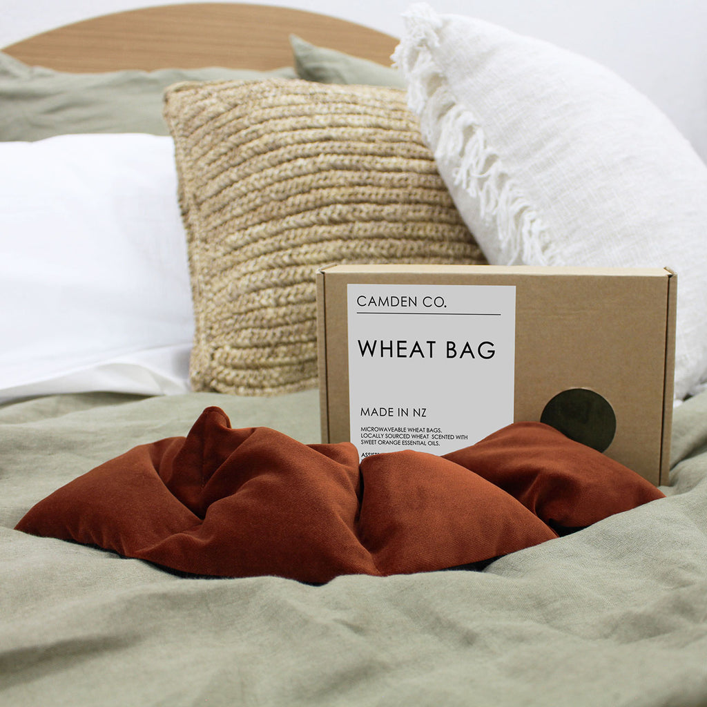 Camden Co Wheat Bags are a popular designer version of the old fashioned Wheat Bag. Handcrafted in New Zealand from locally grown wheat and locally sourced fabric.With a range of contemporary colours and modern textures to choose from, their Therapy Wheat Bags are a must have around the home.    All Wheat Bags are scented with Camden Co's iconic scent infused with Sweet Orange.   Heating and cooling instructions come with every Wheat Bag within its own labeled brown box.    Camden Co Wheat Bags soothe aches