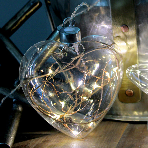 Light up your world with some hanging glass lights. Add a beautiful twinkle to your home, perfect for living, ambience, or special occasions.  10 x warm white LED seed lights Clear Glass - Copper Wire 25cm hanging cord with on/off switch that doubles as a subtle battery pack Powered by CR2032 batteries, included