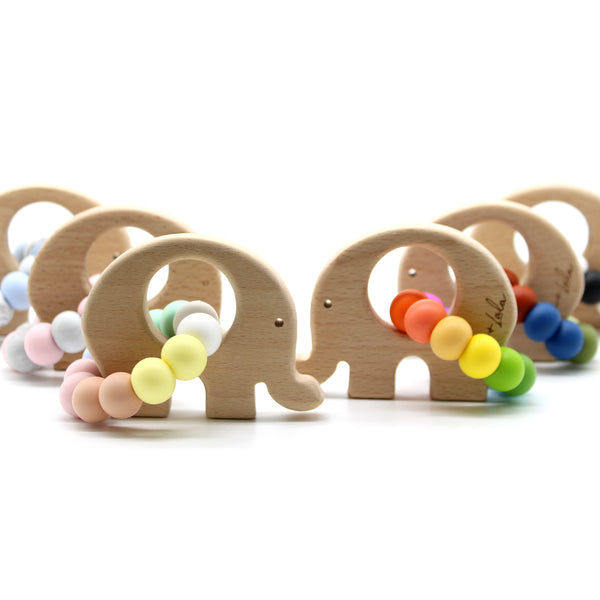 Lulu+Lala's super duper cute and very popular 'ELLE' is the perfect combo of silicone + beechwood.  Perfect for soothing those sore gums!  Our silicone beads are food grade silicone, chewable, non-toxic + resistant to the growth of mould + bacteria.  Beechwood is naturally anti-bacterial and hard wearing.     Available in 6 colour combos.  Safety tested and certified to AS/NZS 8124.