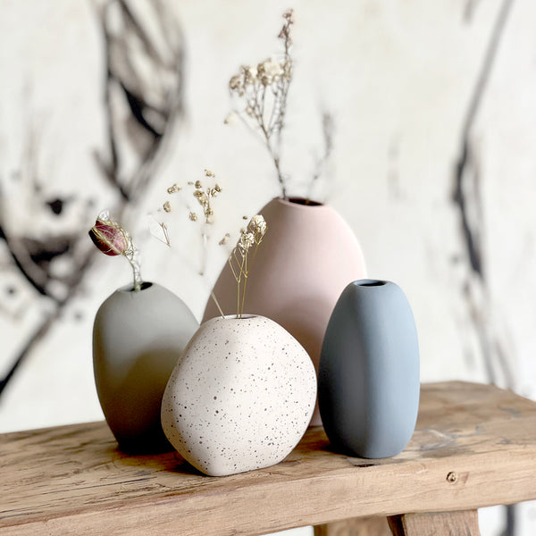 The Harmie Vase  Inspired by Vietnamese Artisans, The Harmie Vase, gives that hand-crafted feel, moulded into organic seed-like shapes, in a modern colour palette.  Sizes are from 7cm high to 11cm high