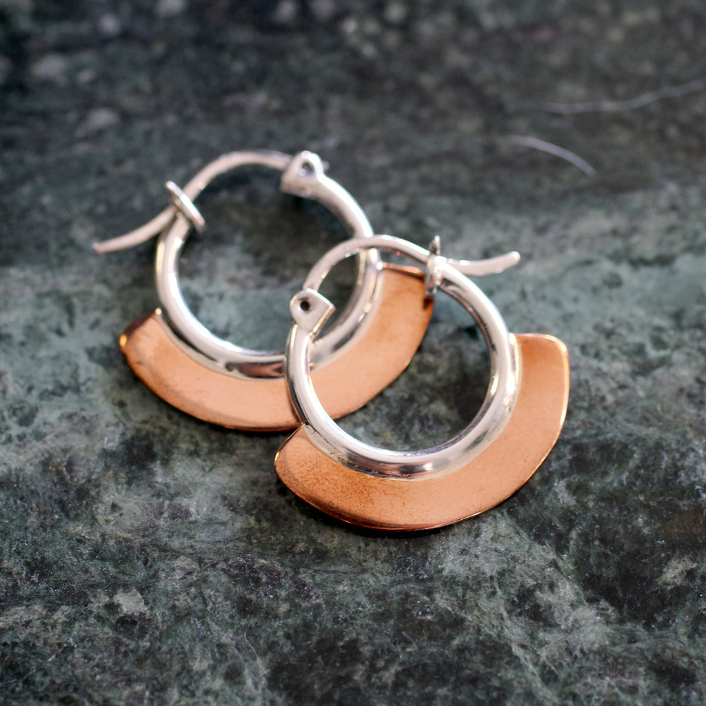 silver copper hoops This unique collection is sourced from Southern Mexico, Morocco, Peru and Ecuador. Due to the hand made quality of this silver jewellery no two pieces will be exactly the same. All silver jewellery is made from quality sterling or fine silver.   • silver - copper plated  • Please handle our silver pieces with extra care. Silver can bend, but beware because it can also snap if thin and not supported correctly. • Avoid contact with perfume or liquids. • Clean gently with a silver cloth or