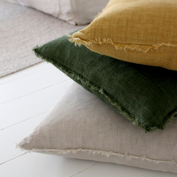 Kobo cushion Set a relaxed tone with the earthy shades and softly fringed edge of the Kobo cushion. The linen has been hand dyed, then enzymed washed to give a gently distressed finish and a softer handle.  Comes with feather inner and zip closure. 100 % linen  Size: 40 x 60cm