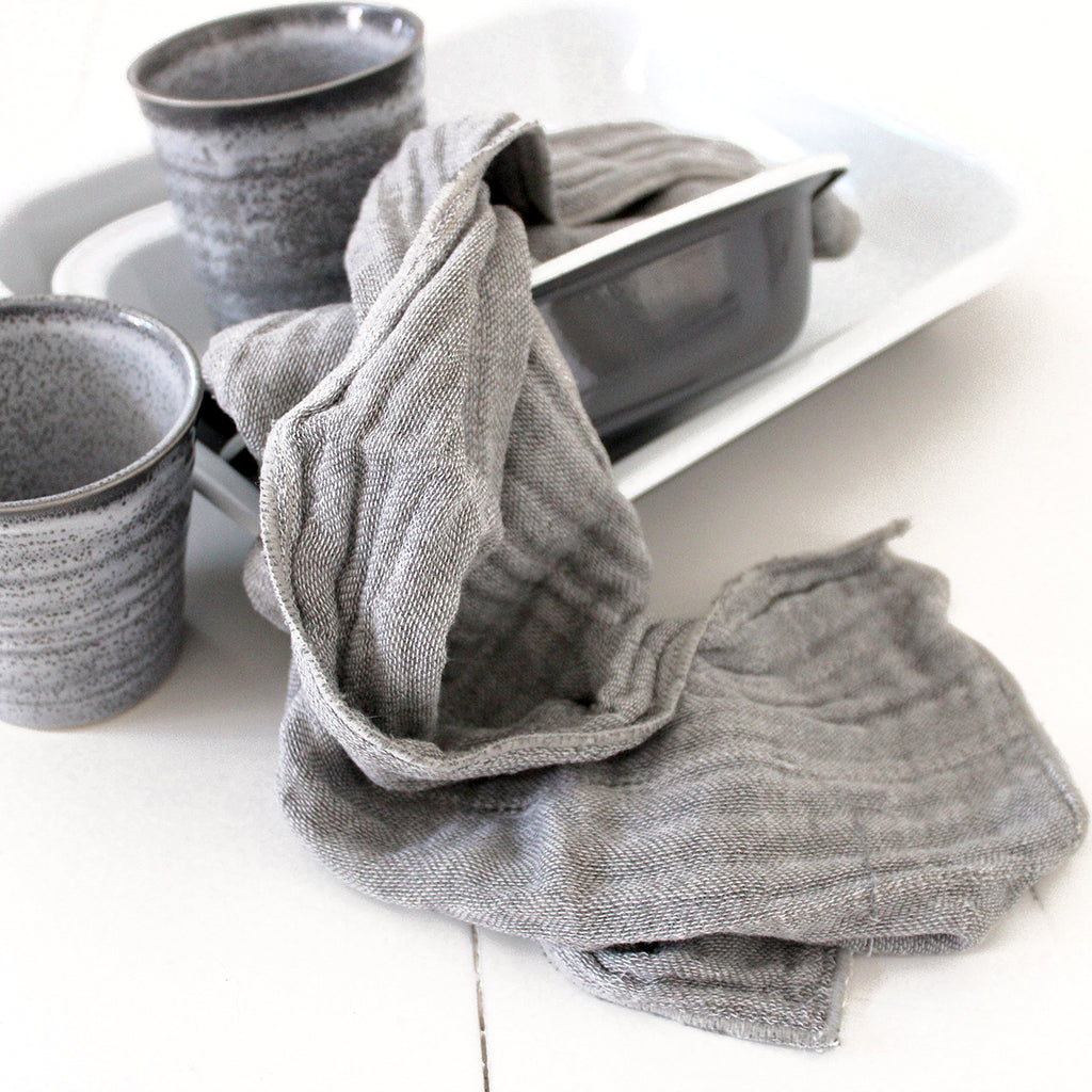 Nawrap natural dishcloth + tea towel Nawrap's signature binchotan dishcloth/tea towel is anti-microbial and anti-odor. The dish cloth features a distinctive weave not seen outside of Japan. Binchotan is a Japanese oak charcoal prized for its purifying powers. Featuring a 6 layer weave that increases water absorbency and durability. Textured surface means better cleaning power while damp. Dries quickly after use. Avoid contact with bleach and do not put in the dryer.   Once you've tried these you will never
