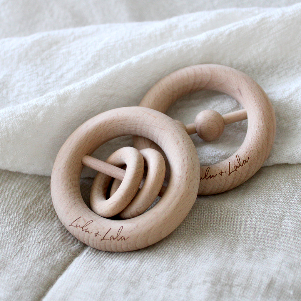 EO features 2 round rings that slide and make a subtle sound when shaken.   LIAM features 2 round beads that slide and make a subtle sound when shaken.   Very popular for those wanting a natural teether + rattle.   Beechwood is perfect for teething babies, hard wearing + naturally antibacterial  Eco-friendly, easy to grasp and rattle.  Leo and Liam both make a wonderful keepsake piece for your little one.  Safety tested and certified to AS/NZS 8124.