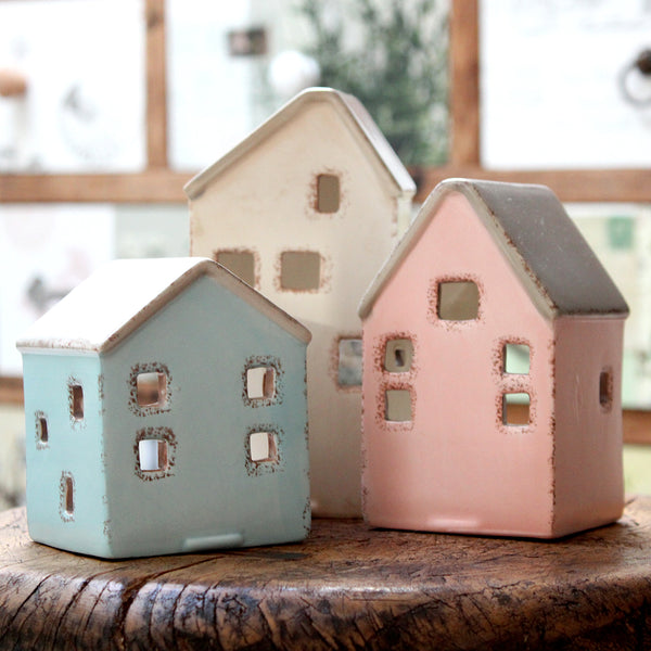 This house-shaped tealight holder will look beautiful displayed in a lounge, hallway or anywhere you need to add style and ambience.  Featuring little cut out windows which allow the candle glow to shine through.  Wonderful on its own or pair with the other colours/sizes. A great gift idea.  Blue/brown house size: 73 x 71 x 90mm  Pink/brown house size: 71 x 71 x 113mm  Brown house size: 74mm x 74mm x 145mm   Made of 100% Dolomite