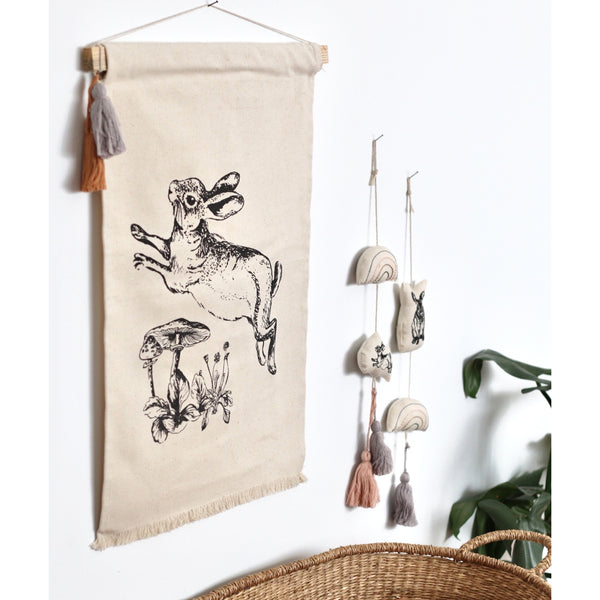 The Burrowers wall banners have been hand screen printed onto 100% GOTS certified organic cotton.  The natural unbleached colour of the cotton give an earthy feel perfect for that nutral nursery.    Each banner comes with a grey tassel attached but you can change up the colours or add extra tassels by purchacing a set of the six additional essential coloured tassels.  The banners come in the three varients - Baxter, Mr Hopkins and Leap.  Each sold seperately in their own gift box.  Wall banners measure 40cm