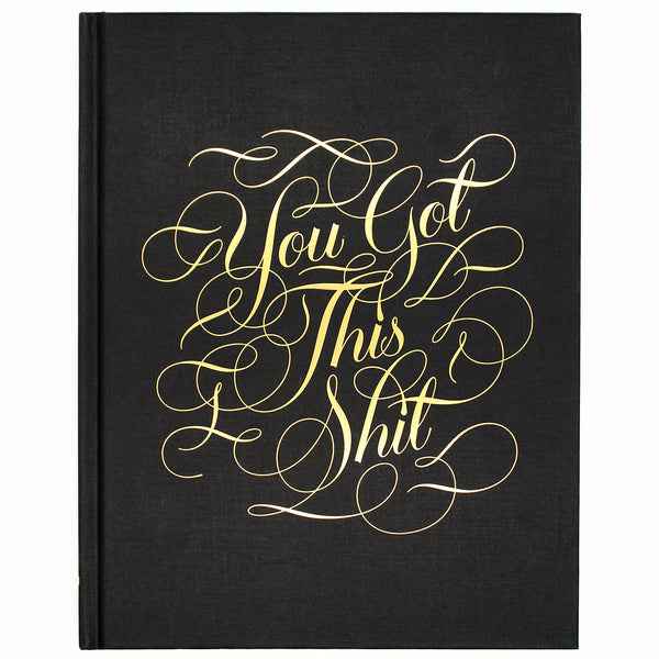 From our bestselling Calligraphuck line, this luxe hardbound journal features uplifting profanity in gold foil-stamped calligraphy on the cover.  With gilded edges, lined and blank pages, and metallic flourishes throughout, 'You Got This Shit' is the journal for anyone who appreciates sassy words of encouragement.  Size: 19 W x 24 L cm