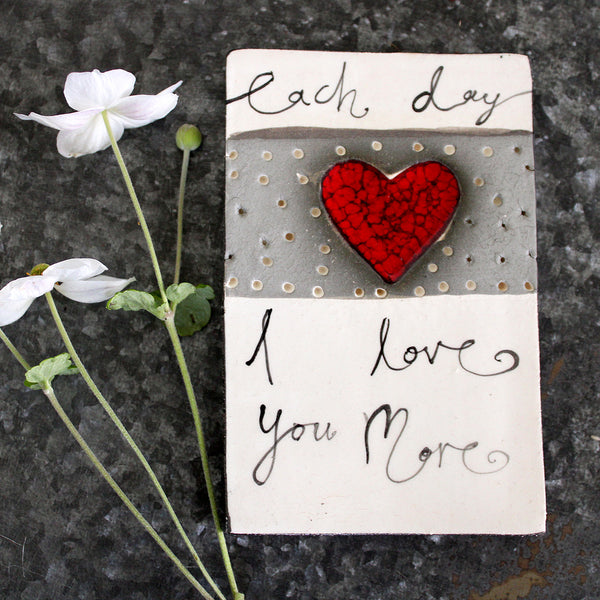 Handmade in NZ!  Ceramic tile featuring an imprinted heart and a beautiful quote.  Ideal for the wall or adorn any coffee table or bedside table in the house.  Size: 11 W x 16.5 L x 1.7 H cm approx