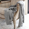 Agne Cotton Throw Add a touch of playfulness to the room with this delightfully tactile throw. The soft cotton knit is complimented by a fine-gauge moss stitch border.  Size: 125 x 150cm   100% Cotton