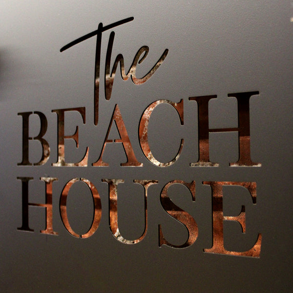 Black Steel - The Beach House The perfect welcome sign for your Beach House. Suitable for indoors or outdoors, The Beach House sign measures 400mm diameter and includes 1 metre of quality jute hemp rope.  Cut from premium quality stainless steel, A Beach House is finished in electro coated matte black.  Suitable for outdoor use. The perfect sign for your beach house - or a fabulous gift! Lisa Sarah Designs