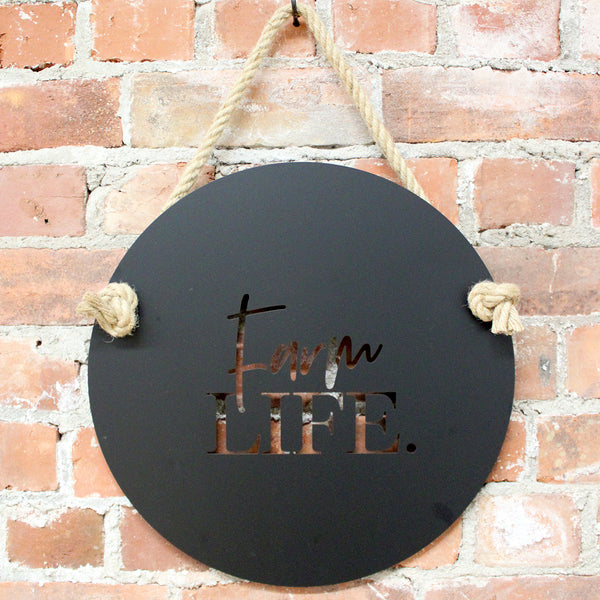 "Black Steel - Farm Life The perfect welcome sign for your Farm. Suitable for indoors or outdoors, Farm Life measures 400mm diameter and includes one metre of quality jute hemp rope.  Cut from premium quality stainless steel, ""Farm Life"" is finished in electro coated matte black.  Suitable for outdoor use.  The perfect sign for your farm - or a fabulous gift! Lisa Sarah Designs"