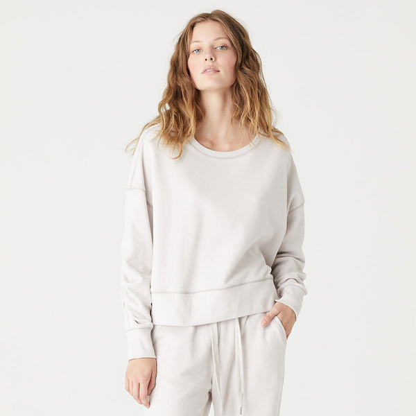 The Lana Crop Sweat is an elevated, relaxed-fit, crop sweatshirt crafted from 100% GOTS Certified Ultra-Lightweight Organic Cotton. Featuring rouched sleeve detail and a soft peached fabric hand-feel.  • Rouched detail on sleeves • Peached finish • Ribbed crew neckline and hemline • Long sleeves; ribbed cuffs • Fabric: 100% GOTS Certified Ultra-Lightweight Organic Cotton French Terry (Global Organic Textile Standard)