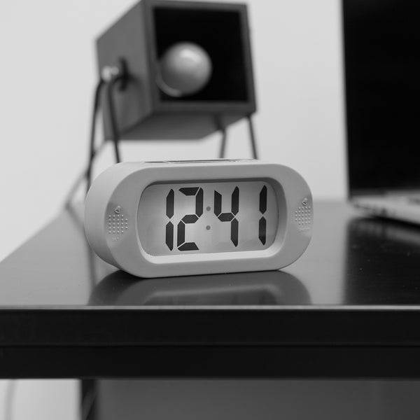 Gummy Alarm Clock Now you can fall asleep in peace! No ticking, no bright lights. Simply hit a button when it is dark to view the time.  Available in black or white Silicon Excl 3 AAA batteries Digital clock, no ticking  Size: 14 x 7 x 5cm