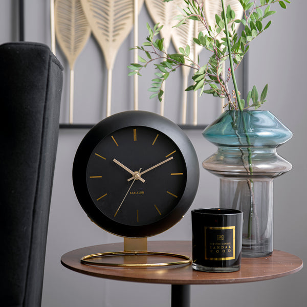 karlsson globe table clock Karlsson is a renowned Dutch clock brand and is sold all over the world. The Karlsson brand is one that's synonymous with good quality, stunning graphics, aesthetic shapes and innovative design.  Excl. AA batteries. We advise the use of Energizer Lithium batteries for all Karlsson clocks. As a KARLSSON DEALER in New Zealand we can offer you a large range of these quality clocks, which all come with a two year KARLSSON WARRANTY.   • Table clock Globe Iron • Large - D. 21cm, H. 24.5
