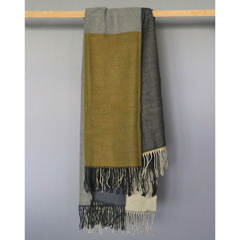 Nestle down on the cooler evenings with this delightful soft weave throw.  It is available in 4 two-toned colours all with a delicate tasselled edge.  Size: 130x150cm 100% Acrylic