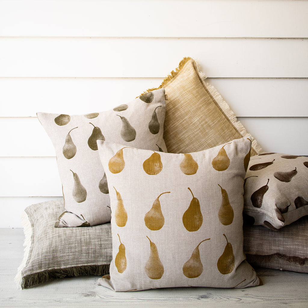 Pear cushion. Recycled cotton cushion screen printed with a pear repeat design.  Measures 45 x 45cm.  Supplied with high quality feather inner.