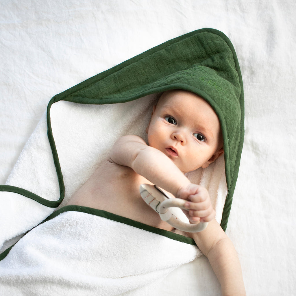 These gorgeous, baby hooded towels are made from 100% GOTS certified organic cotton.  Each towel is made from beautiful soft terry towelling and bound with our 7 Essentials colours.  The hood is detailed with a layer of coloured muslin and the Burrow and Be logo subtly embroidered.  Pair with any of our Essentials accessories or match the colour with a piece of clothing for a stunning baby shower gift.  Designed in New Zealand  Ethically made in India