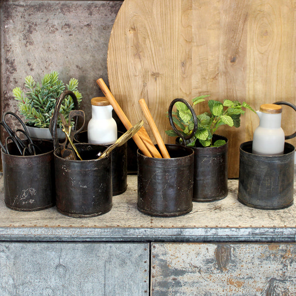 These recycled metal herb pots are handy for just about anything. Use them in the kitchen for your herbs, utensils, oil bottles and kitchen scissors. They make a great table centre piece for dried flowers or succulents or even a pen jar for your office.  These pots have been handcrafted using traditional methods, three sizes to choose from.
