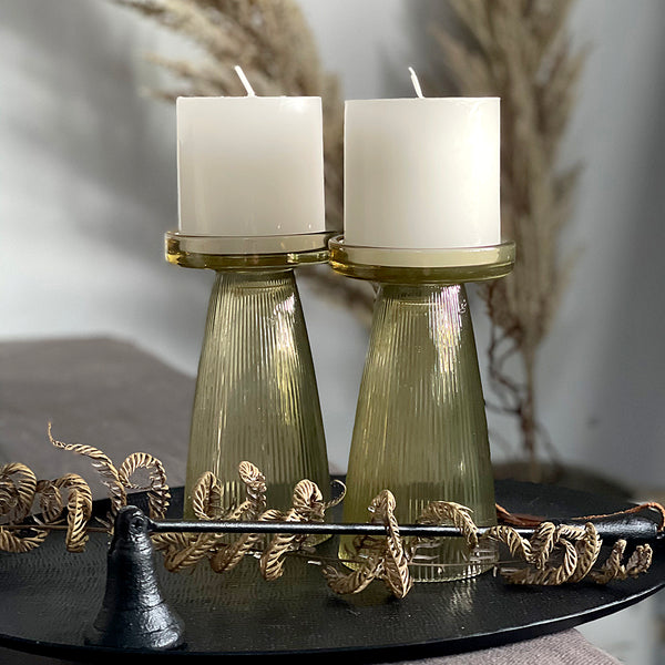 Gorgeous set of two ripple glass candle holders. Available in three colours. Candles are not included.  Size: 9 x 16cm H