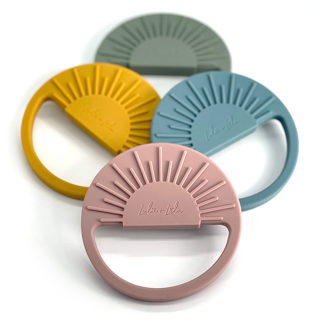 The Sunshine Teethers are the perfect size and shape for little hands to grasp while massaging their gums.  • Featuring raised front and back texture that will massage their gums. • Freezer friendly for a cooling relief • 100% soft food-grade silicone • Free of BPA and non-toxic • AS/NZS 8124 compliant • Suitable from 3mth +