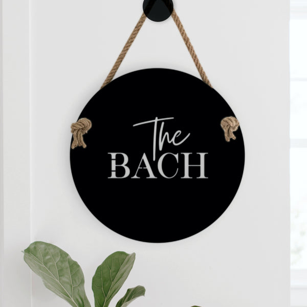 The perfect welcome sign for your bach or beach house. Suitable for indoors or outdoors, The Bach measures 400mm diameter and includes 1 metre of quality jute hemp rope.  Cut from premium quality stainless steel, The Bach is finished in electro coated matte black.  Suitable for outdoor use. The perfect sign for your beach house or for a beach lover at home.