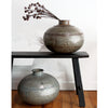 Wonderfully rustic, with exposed rivets, no two pots are the same. These make a great statement on their own or use them to display a few dried flowers.  The Torlouse Iron Pot can be used outside however they will age and some surface rust may occur over time. This can be minimized by spraying with a product like Penetrol  Handcrafted using recycled iron.  Size:  H29 x D35cm