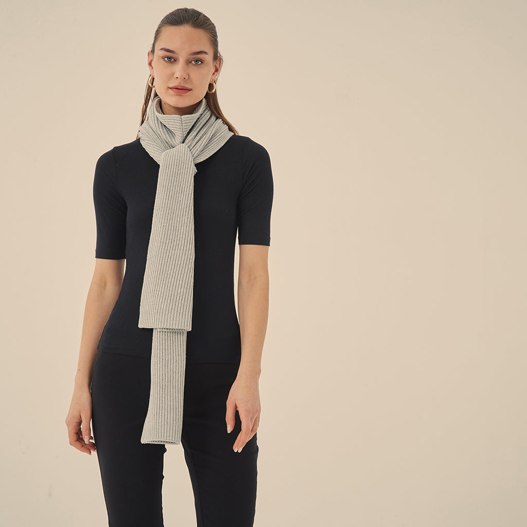 Versatile is the key here, this scarf can be styled forwards, backwards, crossed over, hanging straight, tied in a knot... the options are endless. Crafted from mid-weight cotton blended yarn this scarf is the perfect accessory to add extra style and warmth to any outfit.   Fabrication: 60% Cotton, 20% Viscose, 20% Modal