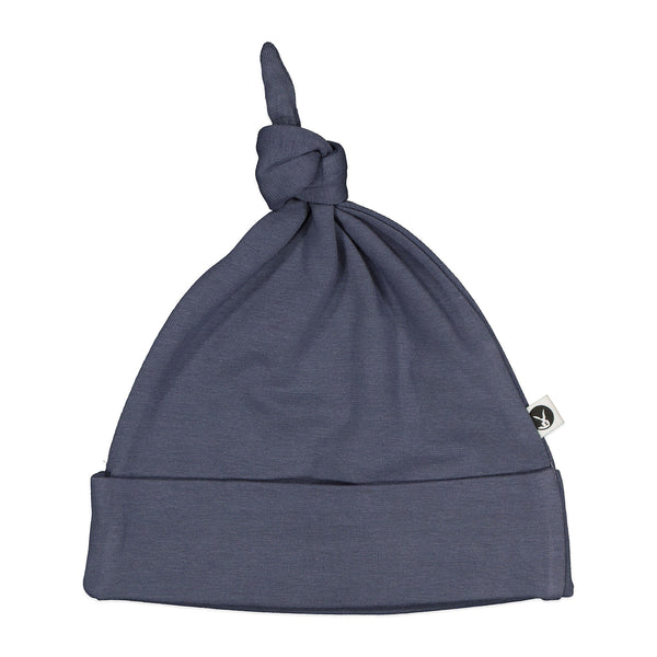 The Essentials top knot hats are cosy and warm with lots of stretch.  Great as an extra gift idea to pair with a swaddle or wrap.   Made from 95% GOTS certified organic cotton, 5% Elastane   Designed in New Zealand   Ethically made by our friends in India
