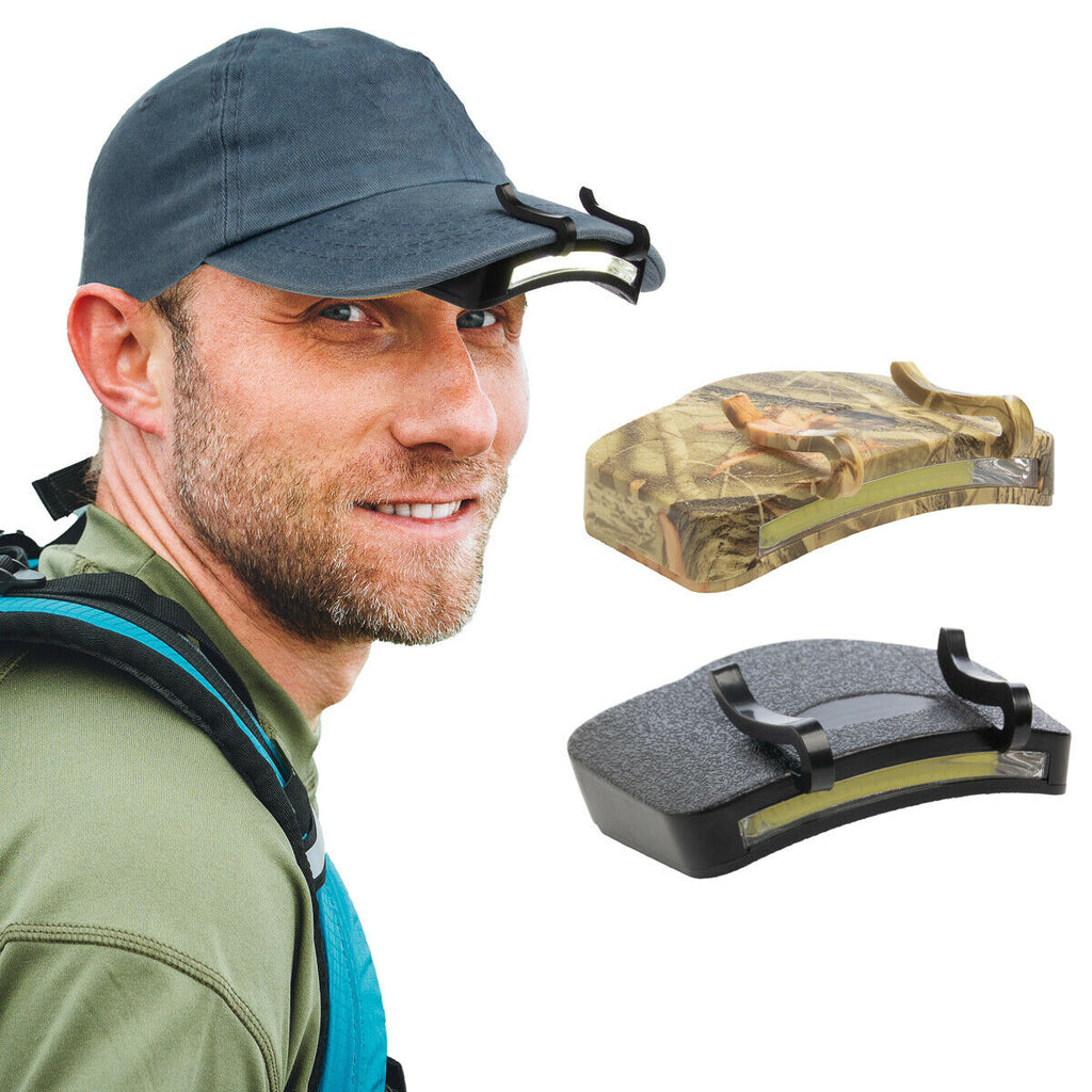 A man with a flashlight attached on his hat with clips