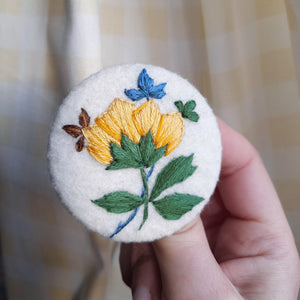 floral embroidered badge