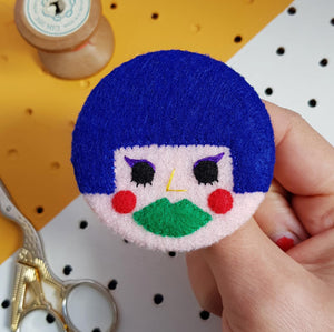 felt face badge with blue hair and green lips