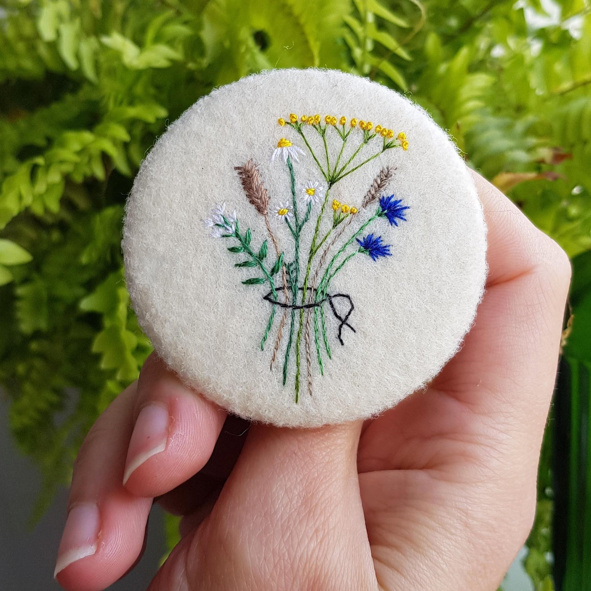 large felt badge with hand embroidered wild flowers